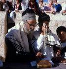 Israel Jerusalem Sephardic Rabbi and a boy kissing the prayer shawl
