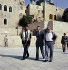 Israel, Jerusalem, three Jews walking away from the Western Wall deep in conversation