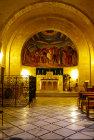 Israel, Jerusalem, Bethphage Franciscan church interior, Altar and mural showing Palm Sunday