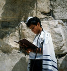Israel Jerusalem Sephardic Jewish boy reading his prayer by the Western Wall at his Bar mitzvah