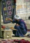 Bedouin trader checking his wares, Bedouin market, Beersheva, Israel