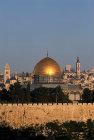 Israel, Jerusalem, sunrise lights up the Old City, the Dome of the Rock and west Jerusalem