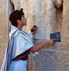 Israel Jerusalem Sephardic Jewish boy praying at the Western Wall during his  Bar mitzvah