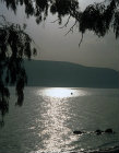 Israel, the Sea of Galilee and a fishing boat at sunrise