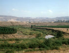 Israel, a loop of the River Jordan South of Galilee, Gilead Mountains in Jordan beyond, taken in 1984 before excessive extraction reduced its flow