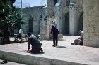 Israel, Jerusalem, man kneels for prayer