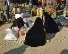 Israel, Beersheva, market, Bedouin women buying wool