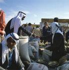 Israel, Beersheva, market, Arabs bargaining  over a sack of almonds