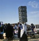 Israel, Beersheva, market, Bedouin woman carrying four crates on her head