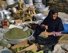 Israel, Beersheva, market, Bedouin woman scooping up tea