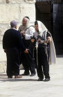 Israel, Jerusalem, two Orthodox Jews and a tourist at the Western Wall