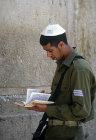 Israel,  Jerusalem,  a Jewish soldier reading from the Jewish Bible at the Western Wall