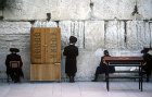 Israel, Jerusalem, Orthodox Jews praying at the Western Wall by the Torah cabinet