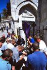 Israel, Jerusalem, Via Dolorosa, Good Friday Procession, Polish Roman Catholics pray at the third station of the cross