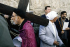 Israel, Jerusalem, Via Dolorosa, Good Friday Procession, Roman Catholic Cleric carrying the cross