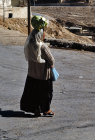 Israel, Arab woman carrying her shopping on her head