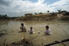 Christian Orthodox baptism at Qasr El-Yahud, on the river Jordan, reputed site of Christ