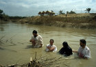 Christian Orthodox baptism at Qasr El-Yahud, on the river Jordan, reputed site of Christ