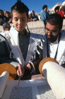 Israel Jerusalem a Bar mitzvah, boy holding a Yad whilst reading from the Torah