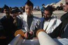 Israel Jerusalem Western Wall a Bar mitzvah, boy holding a Yad whilst reading from the Torah