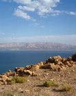 Israel, Hills of Moab and Dead Sea over rocks