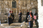 Israel, Jerusalem, Easter Sunday Procession to the Holy Sepulchre Church, four Turkish guards and friars