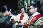 Israel, Jerusalem, Easter Sunday, Roman Catholic Mass in the Holy Sepulchre Church, communicant receiving holy communion
