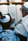 Israel Jerusalem Sephardic Jewish boy reading the Torah at his Bar Mitzvah ceremony