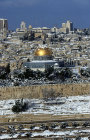 Israel, Jerusalem, Old City view after snow storm, top of the Dome of the Rock covered with snow