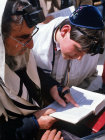 Israel Jerusalem Jewish boy reading the prayer book before his Bar mitzvah