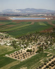 Israel, aerial view of cultivated fields in Jezreel Valley, reservoir in background