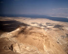Israel, Masada, aerial view from south south west of the ancient fortification  with Roman ramp highlighted on the left and the Dead Sea behind