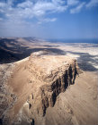 Israel, Masada, aerial view from the south of the ancient fortification on the eastern edge of the Judean desert, with the Dead Sea beyond