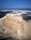 Israel, Masada, ancient fortification on the eastern edge of the Judean desert, aerial long shot from south south west with the Dead Sea beyond
