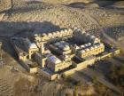 Nebi Musa, aerial view of 13th century Islamic mosque surrounded by Bedouin burial grounds, Judean desert, Palestine