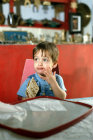 Israel little Jewish boy eating matzot at Passover