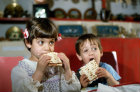Israel Jewish boy and girl eating matzot at Passover