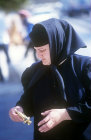 Russian Orthodox nun shopping on the Mount of Olives Jerusalem, Israel