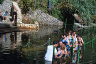 Pentecostals being baptised in the Jordan river, Israel