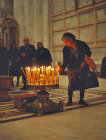 Israel, Jerusalem, Greek Cypriot woman placing a candle in the Holy Sepulchre Church