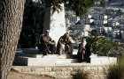 Israel, Jerusalem, three Arab men passing the time of day