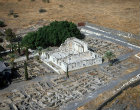 Synagogue, third or fourth century, and surrounding buildings from south east, aerial, Capernaum, Israel