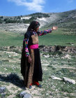 Israel, Bedouin girl pointing to her sheep