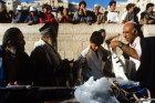 Israel Jerusalem Sephardic Jewish boy being helped to put on his Tallit  prayer shawl at his bar mitzvah