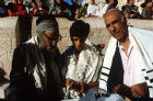 Israel Jerusalem Sephardic Bar mitzvah the Rabbi with the boy and his Father, the boy is holding the fringe of his tallit