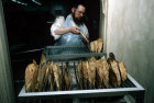 Israel Jerusalem Ultra-Orthodox Jews make Matza for Pesach  Passover Festival Jew removing matza from the baking rack