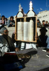 Israel Jerusalem Sephardic Jew raising the Torah  with a Rabbi at a Bar Mitzvah ceremony