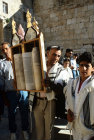 Israel Jerusalem Sephardic Jew raising the Torah at Barmitzvah ceremomy at the Western Wall