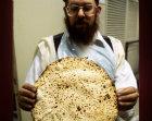 Israel Jerusalem Ultra Orthodox Jew holding up a Matza