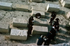 Israel Jerusalem strict Orthodox Jews around grave in cemetery on the Mount of Olives